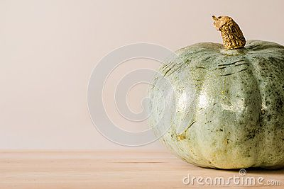 Single medium sized greenish-blue pumpkin with ad space.