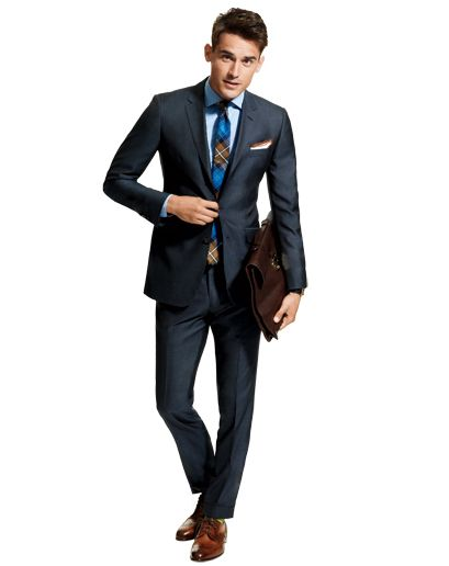 The Tie Adds Something Extra to This Suit & The Pocket Square.