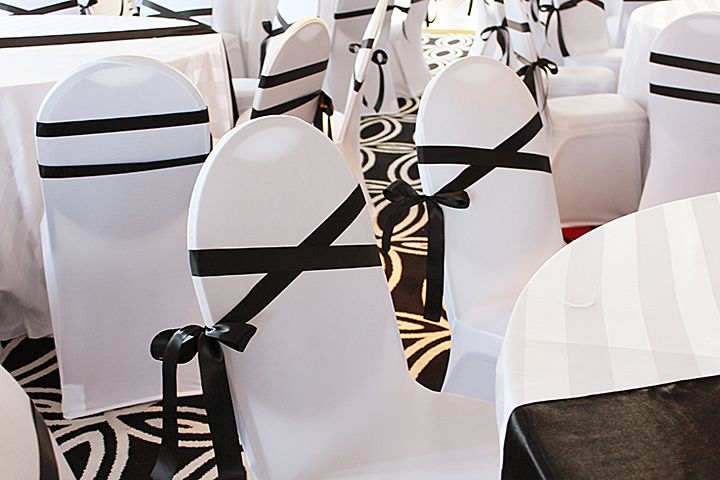 CHANEL theme event ideas - white chair cover rental black ribbon upgrade sash.