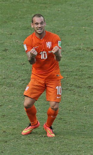 Netherlands' Wesley Sneijder celebrates after the referee decided on penalty during the World Cup round of 16 soccer match between the Netherlands and Mexico at the Arena Castelao in Fortaleza, Brazil, Sunday, June 29, 2014. (AP Photo/Themba Hadebe)