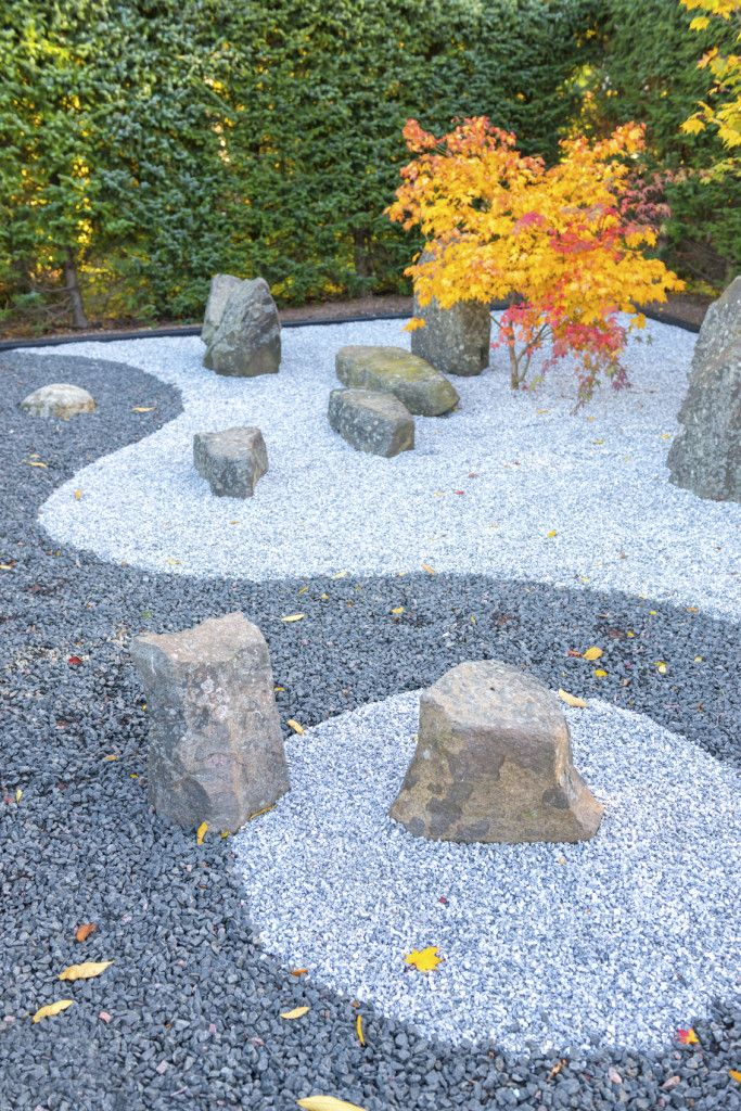 Here is a zen garden with an interesting two-toned stone theme. This design has a very yin and yang feel.
