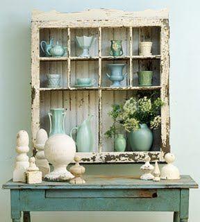 repurposed window as display cabinet