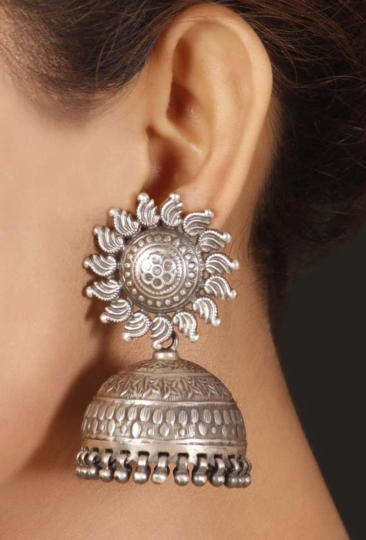 Silver Tribal jhumkaDimensions: L: 2.3 inchesWeight: 58.5gmColor: SilverMaterial: 92.5% sterling silverClosure: Metallic lockFinish: Hand-craftedInspiration: Silver Tribal JewelryShips in 3-5 daysReturns accepted within 10 days of delivery