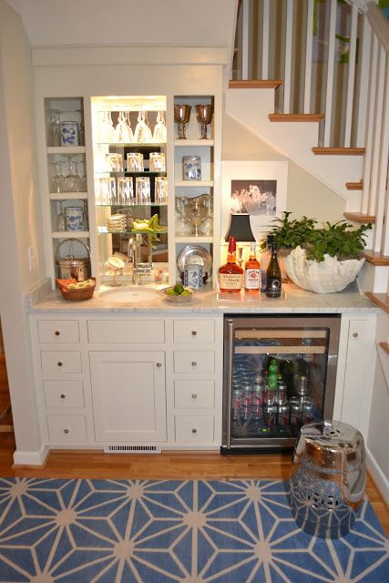 A bar under the stairs. Great for a basement family room! Stock with sodas, popcorn and snacks. Add small microwave on counter. YAY!!!!