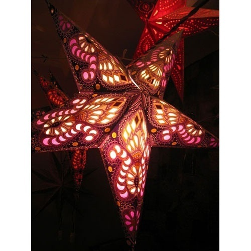 Adding a glowing light to any room dec'd out for Christmas with one of our paper star lamps