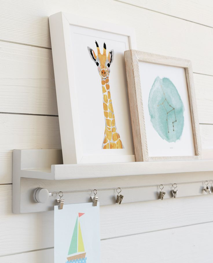Montessori low front-facing bookshelf idea with built in art display.