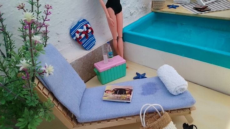 Barbies summer holidays in her private swimming pool