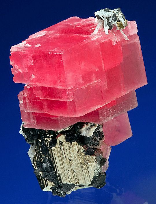 Tremendous specimen of Rhodochrosite atop a large Pyrite with Tetrahedrite and Quartz!  From Collector's Pocket, 2nd Crosscut, Sweet Home Mine, Alma, Colorado.  Measures 5.6 cm by 4 cm by 3.4 cm in total size.  Ex. Bryan Lees Personal Collection  Price $25,000