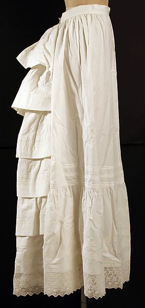 Petticoat Date: 1880s Culture: American Medium: cotton Dimensions: Length at CB: 43 1/2 in. (110.5 cm) Length at CF: 42 in. (106.7 cm) Width at Bottom: 108 in. (274.3 cm) Credit Line: Gift of Miss Charlotte Huffington, 1953 Accession Number: C.I.X.53.15.2