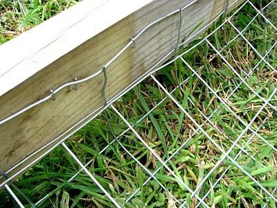 "Simple way to make a wood fence ""dig-proof""."