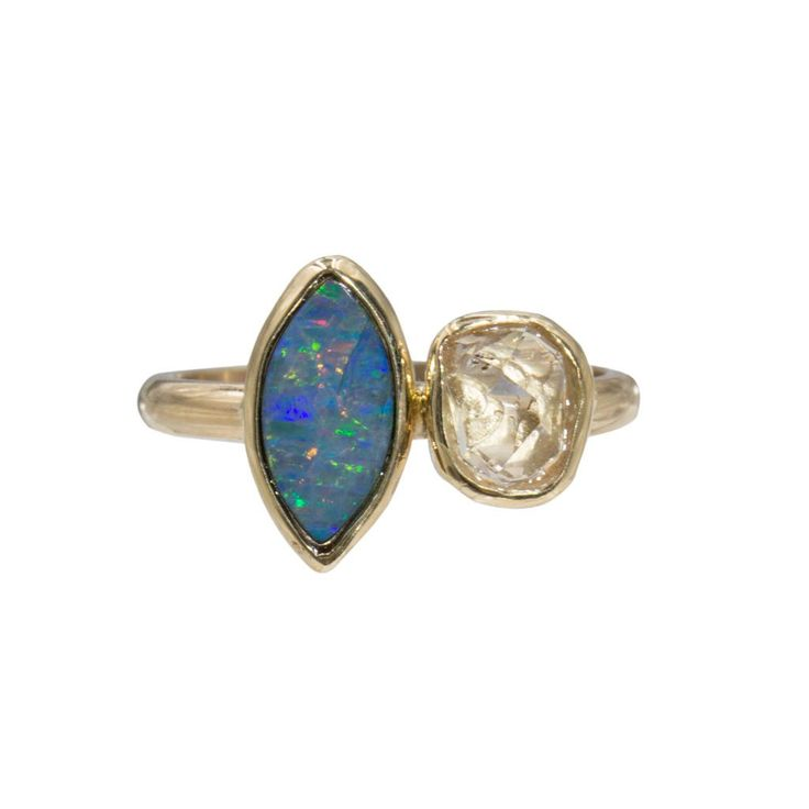 DESCRIPTION: Herkimer Diamond and Opal Ring DETAILED SPECS: Solid 14k Gold GEMSTONE PROPERTIES: