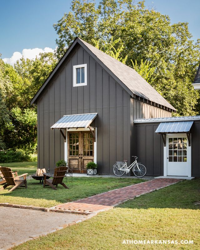 Portrait of a Home | At Home in Arkansas | October 2015| The home's existing garage was removed, and in its place now stands Johnston's new office and studio space, which also serves as an all-purpose room during teen sleepovers and Razorback games. With their unique proportions, the exterior doors to the addition were finds at architectural salvage yards.