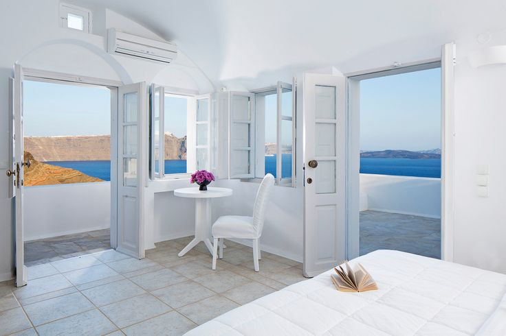 Bright & airy, the Canaves Oia Villa offers a direct connection with the surrounding enchanting nature