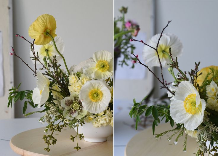 white and lemon centrepiece with poppies, hellebores, seeded gum jonquils and blossom