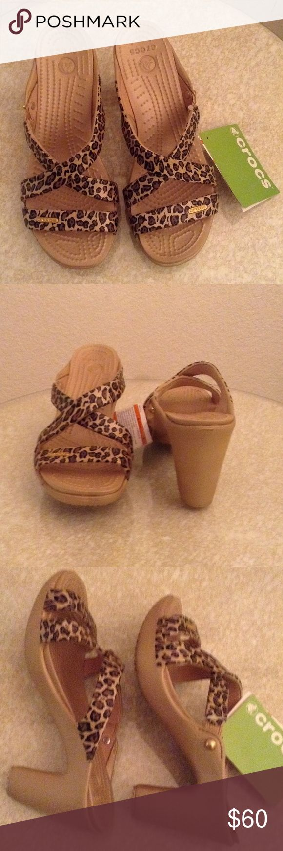 Crocs Animal print high heel Sandals Sz 7 New!!! Crocs animal print sandals, new with tags. Gorgeous sandals that can be worn out, not just in the yard. Size 7 CROCS Shoes Sandals