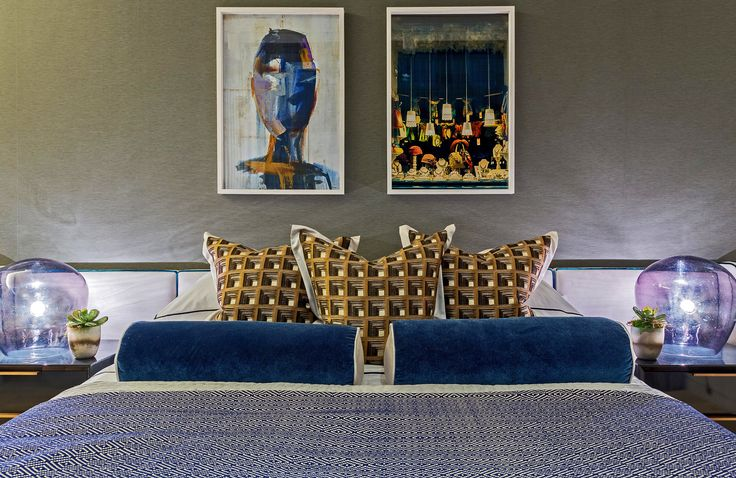 Adding characterful eccentricity to this unique bedroom design, the pair of abstract prints echo the bold colours within our carefully selected soft furnishing fabrics and square Clarke and Clarke cushions, whilst the globe lamps cast a convivial feeling of fun.