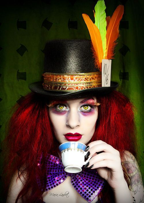 This is the hair and makeup for the Mad Hatter. These vibrant colors used as the eye makeup and bright red hair are what makes this character stand out.