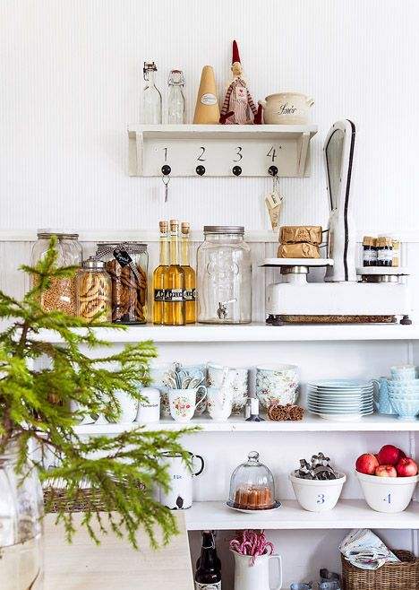 Kitchen storage display on open shelves. Such cute jars and bottles!