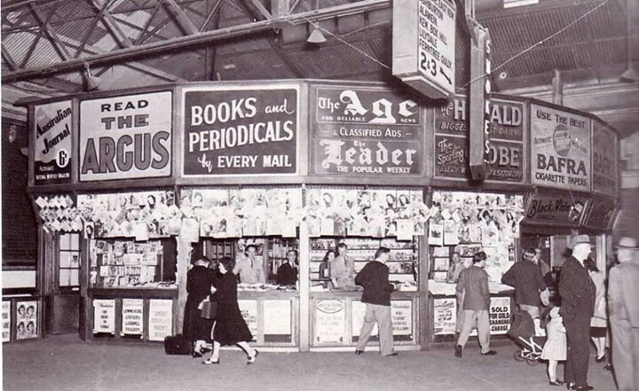 Old news stand Flinders Street Station Concourse MELBOURNE Australia (wish these were still there...they looked great...look at all the mags hanging up)