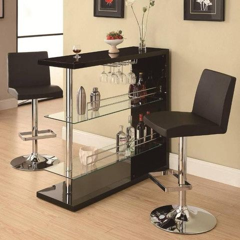"Stunning Black Bar Unit features a high gloss shine and chrome accents. This is a perfect bar for entertaining in smaller homes, condos or 'the man cave'.  Features:  Contemporary Style High Gloss Finish and Chrome Accents 2 Glass Storage Shelves and Wine Glass Holder Black and Chrome Finish 15.8"" x 47.3"" x 44"""