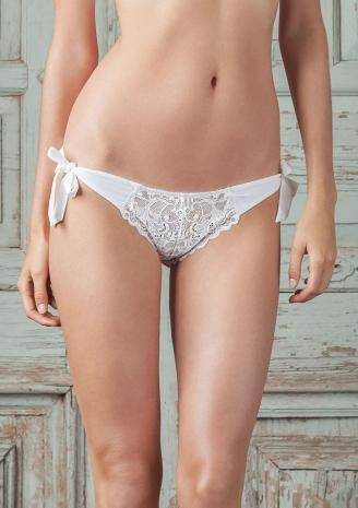 Crafted in our glowing white lace, this irresistible bikini has European crepe chiffon tie sides daringly designed to tease and tempt. Pretty picot edge elastic frames the cheeky crepe chiffon backside.