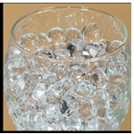 Dew Drops!  These little balls of water are really cool. We use them all the time in arrangements, vases, and even just in jars to add a punch of color.   Clear Dew Drops - Only $7.29
