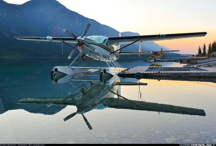 Cessna 208 Aero Twin 850 Caravan N208LB at Muncho Lake-Mile 462 Water Aerodrome in British Columbia, August 2012. The effect of the sunset is embellished by the presence of smoke from forest fires. (Photo: Simon Blakesley)