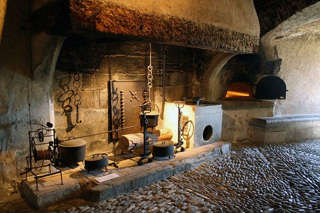 A Medieval kitchen.  Wonder if this is the real thing or a reproduction?  Not many survived the victorians intact.