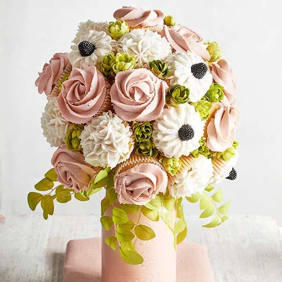 Putting together a gorgeous wedding centerpiece is as easy as making cupcakes! We'll show you how to make this stunning edible cupcake bouquet complete with piping how-tos and decorating ideas. All it takes is a few simple st/