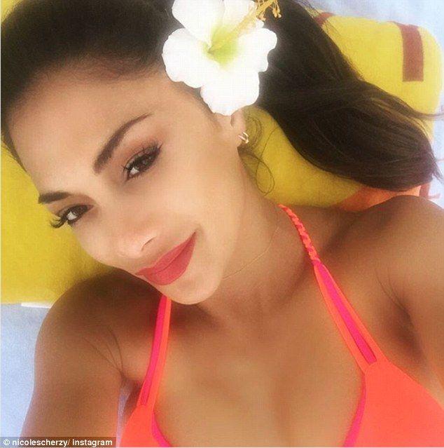 Nicole Scherzinger showcases her curves in a bright bikini in Hawaii #dailymail