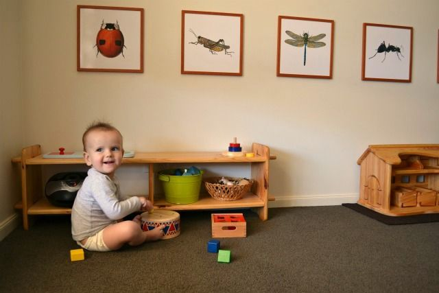 Montessori Room, pictures lower to their level. GREAT blog!