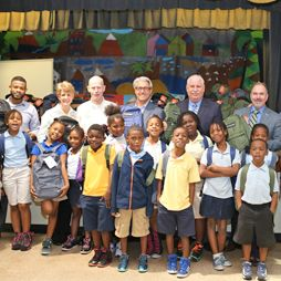 EcoMedia and KINF representatives, Buick and GMC dealers in Miami along with students who received backpacks full of school supplies at Lakeview Elementary School thanks to this joint partnership.