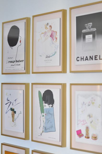 Framed vintage fashion prints. But I would paint or buy black frames with white bases as opposed to that light pink.