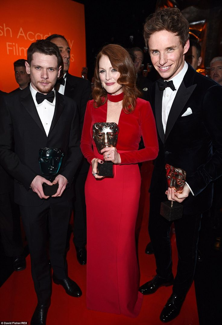 Winners: Rising star Jack O'Connell and Leading Actress Julianne Moore held up their gongs as they posed with Eddie backstage