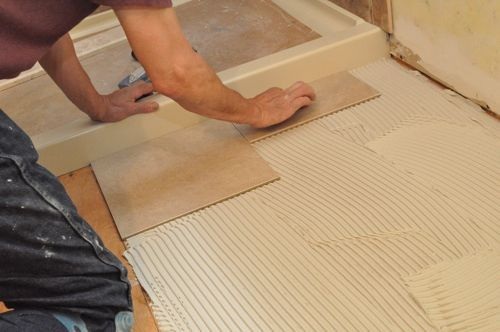 Pro-Tip: Leave a very small joint between the tile and the shower pan. Otherwise, even slight movement can create an irritating, squeaky noise