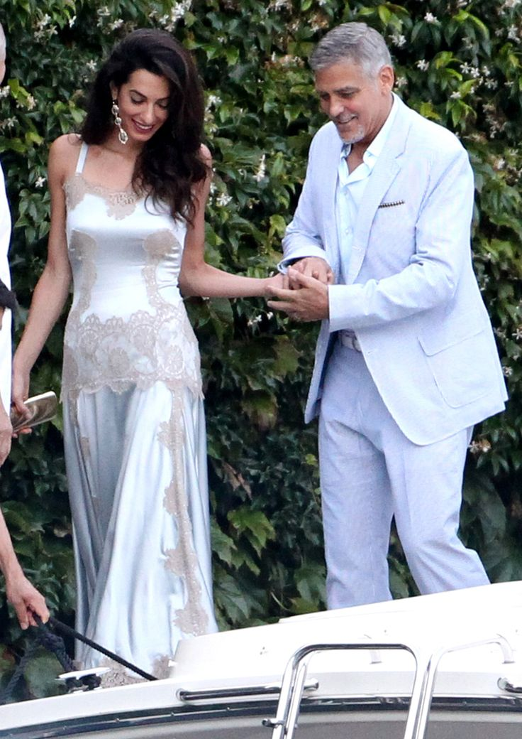 Amal Clooney Is Radiant in a White Lingerie-Inspired Number While Out with George Clooney in Italy from InStyle.com
