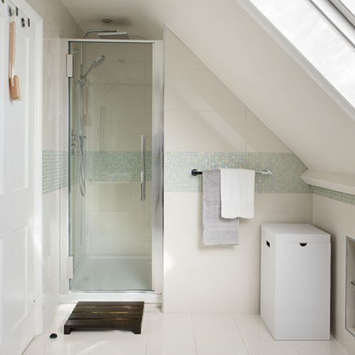 Attic shower room with white tiles and mosaic tile stripe
