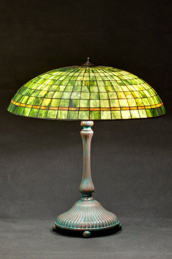 Tiffany stained glass green parasol lamp. Green and amber lamp shade. American glass lamps. Lotus lamp base. Classic green lamp. #tiffanylamps