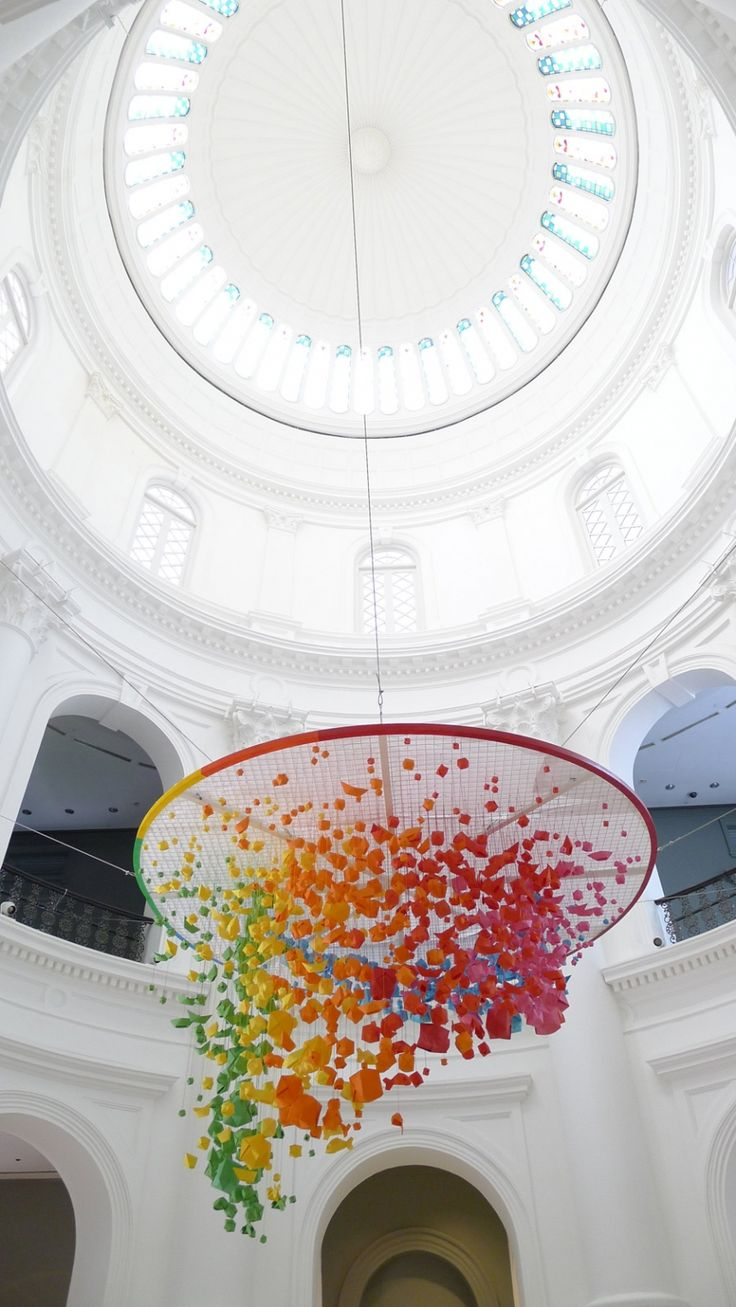 Artist: Mademoiselle Maurice National Museum of Singapore Giant, rainbow hanging installation of 1,000 origami spheres, fish and boats