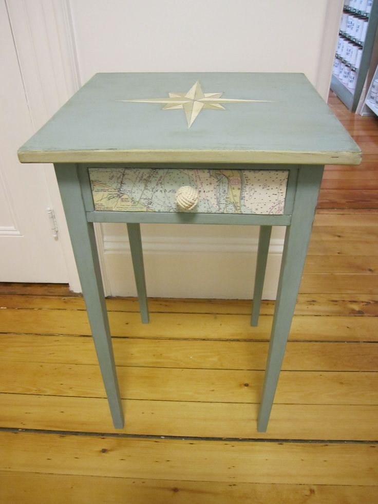 Nancy of Sea Rose Cottage amps up a simple table w nautical map, compass design on top, monkey fist knot pull. Ck it out!