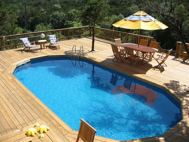 """Texas above ground pool built """"inground"""" style into a deck"""