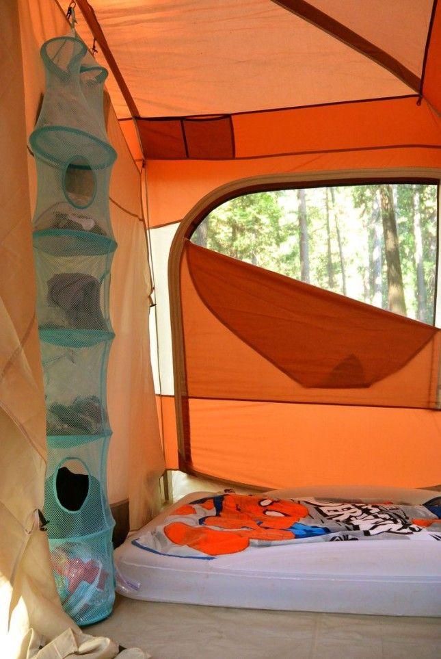 A hanging closet organizer will keep your tent organized. – Brit Morin