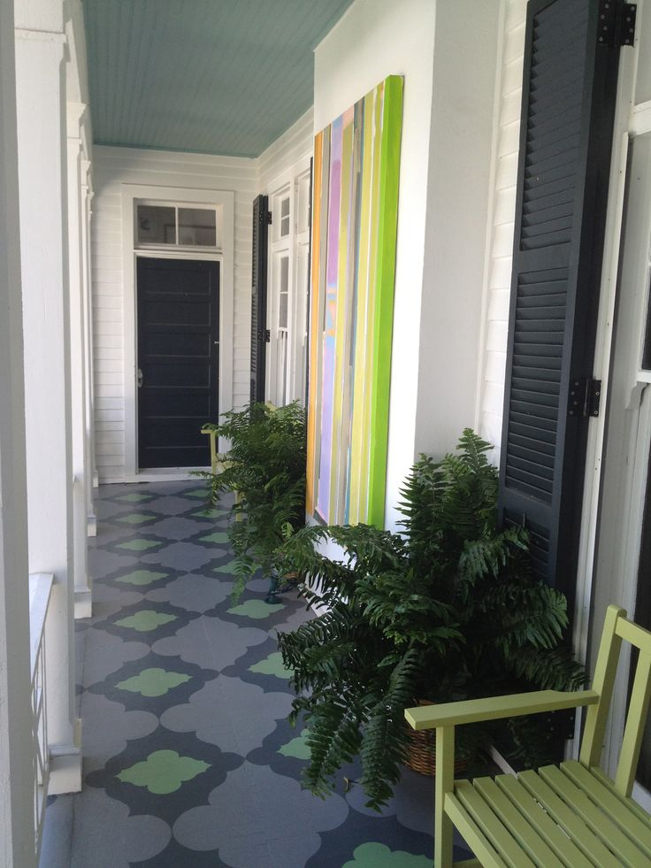 GORGEOUS painted porch floor!  LOVE the art on the wall too!