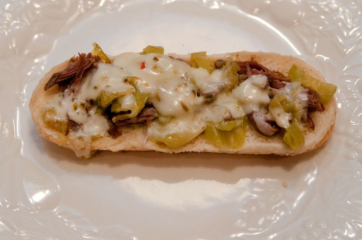 I have made this recipe and it is a favorite at my house. I add a package of AuJus to the meat and peppers. I hadn't thought of the cheese, but that sounds really good.
