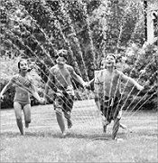 running through the sprinkler****