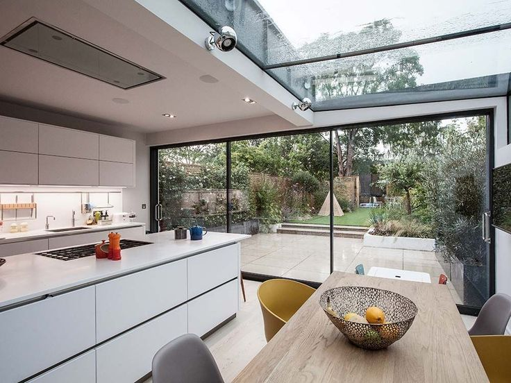 This project includes the complete refurbishment and extension of a 3 storey Victorian terraced house in East Dulwich. The ground floor was extensively remodelled to create a more a free-flowing sequence of open plan contemporary living spaces leading to the new rear extension and garden beyond. The wrap-over structurally glazed roof to the rear extension provides a key design feature allowing natural daylight to flood into the kitchen and dining spaces; while minimal sliding glazed doors…