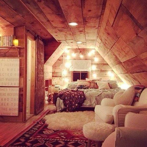 Cabin attic converted into a rustic and comfy bedroom--I don't think I could ever leave.