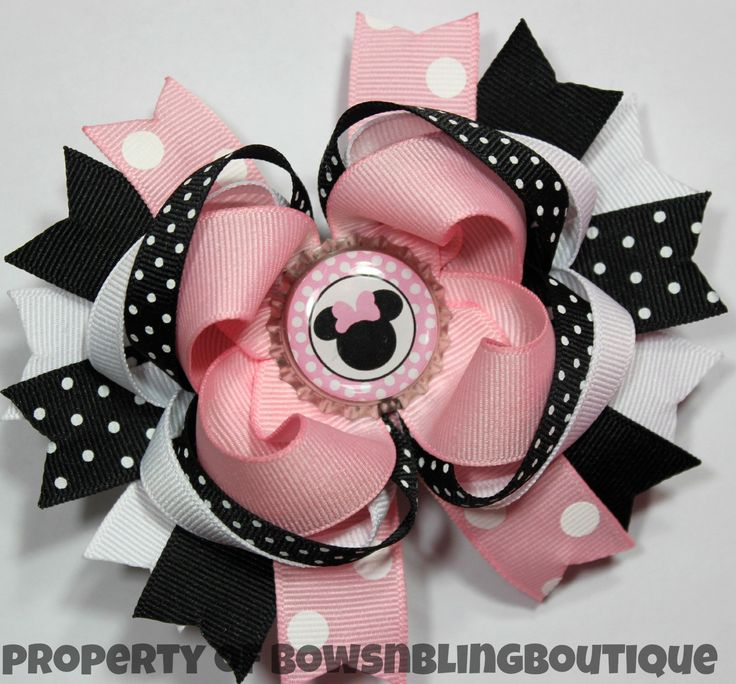 "I love this super cute pink minnie mouse inspired hair bow! The bow is layered with vibrant colors and beautiful ribbon. Each bow pictured measures approximately 4.5""- 5"" across. It is perfect for bab"