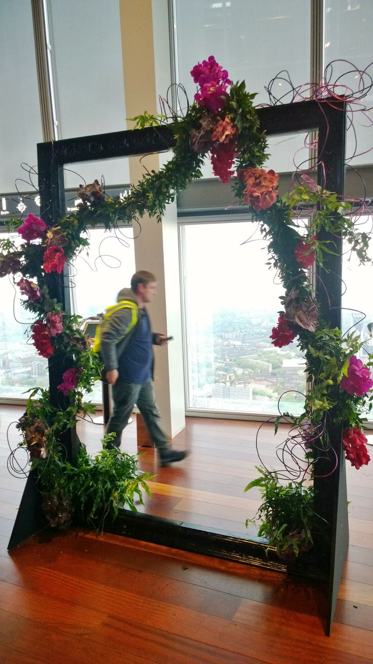 An oversized picture frame for photo opportunities at The Shard. A traditional handmade foliage garland with added Vanda orchids and thick aluminium wire for a younger more edgy look