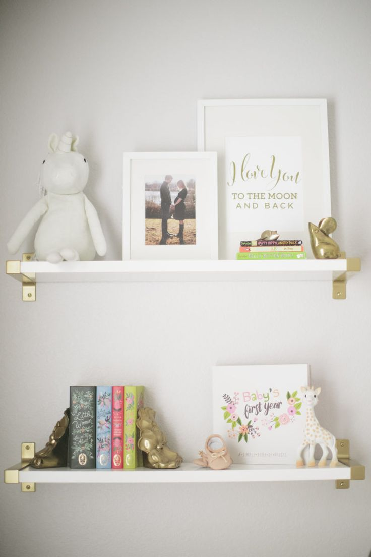 Nursery Shelfie - using IKEA Wall Shelves. Spray paint the brackets a metallic gold for a modern, clean look!
